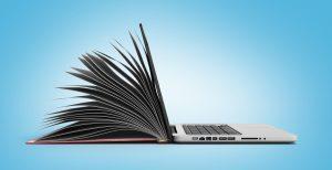 Obrázek knihy přecházející do počítače jako symbolu evoluce.